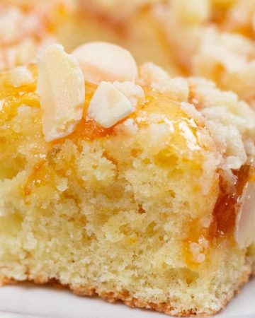 German Crumb Cake or Streuselkuchen is one of the most popular and easiest to make German baked goods. With just a handful of ingredients (and no yeast!), you can have this cake ready to serve about in 45 minutes. #cheerfulcook #Germany #baking #Streuselkuchen #crumbcake ♡ cheerfulcook.com