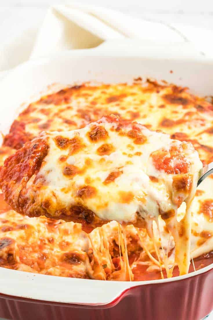 A scoop of breaded chicken parmesan fresh from the oven.