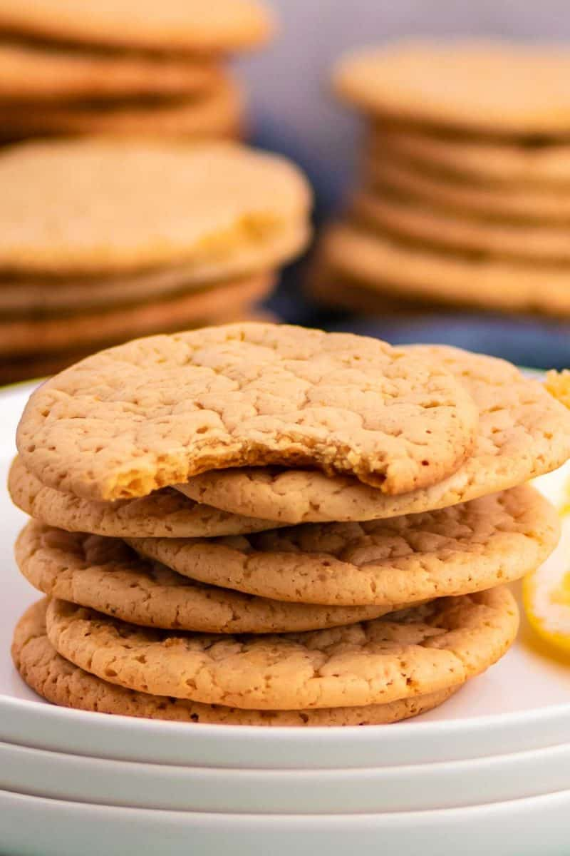 a stack of lemon shortbread cookies on white plates