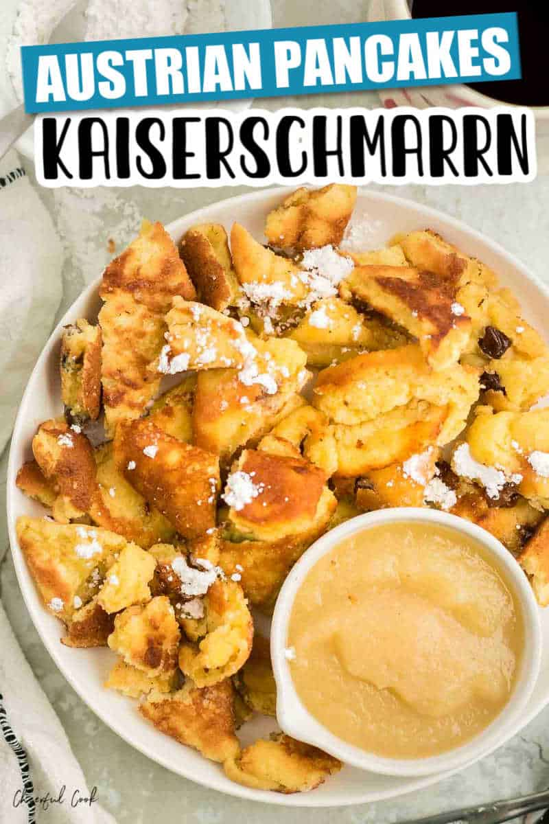 Kaiserschmarrn on a white plate with a side of apple sauce