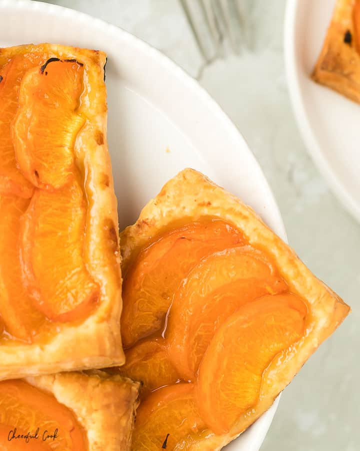 Apricot Tarts on a white cake stand