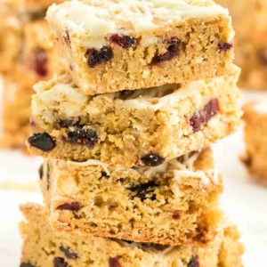 a stack of freshly bake White Chocolate and Cranberry Blondies