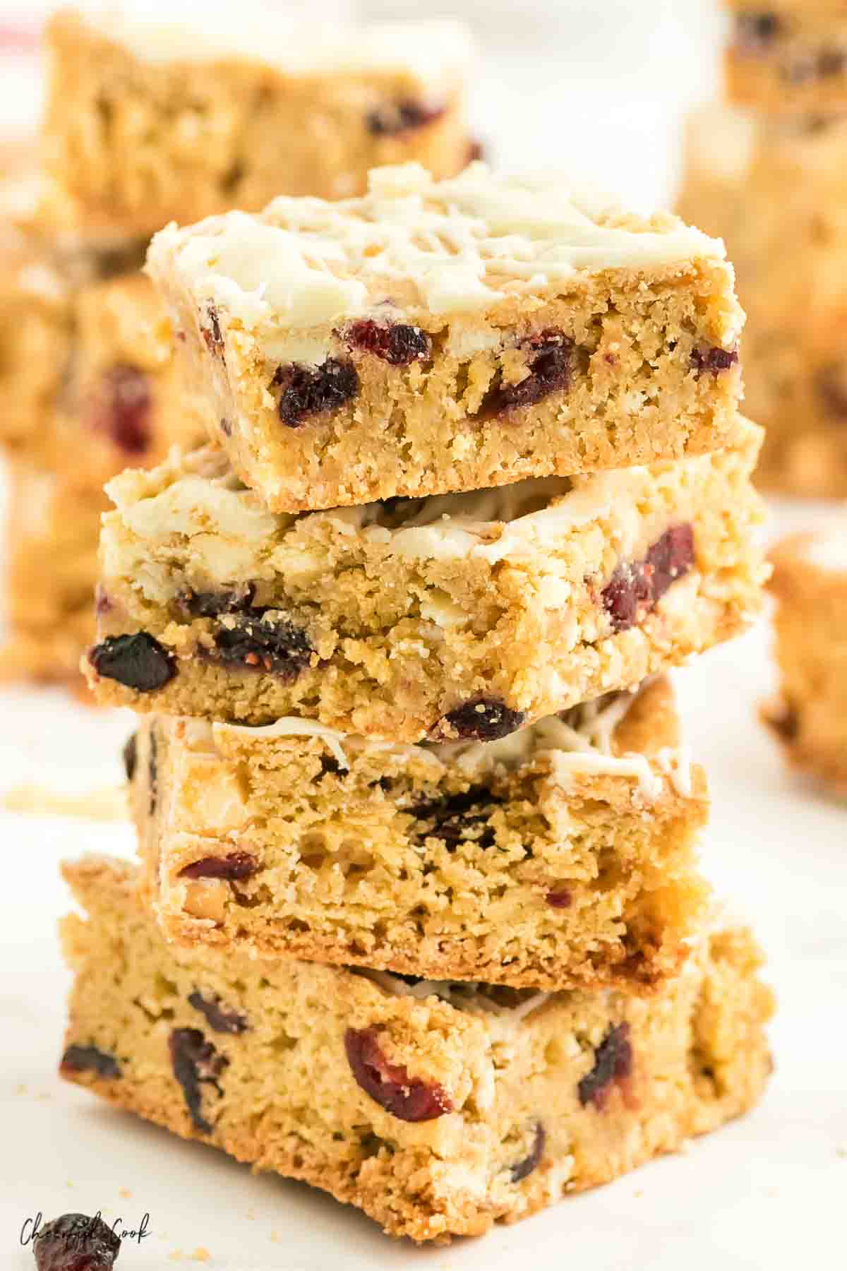 A stack of white chocolate and cranberry blondies