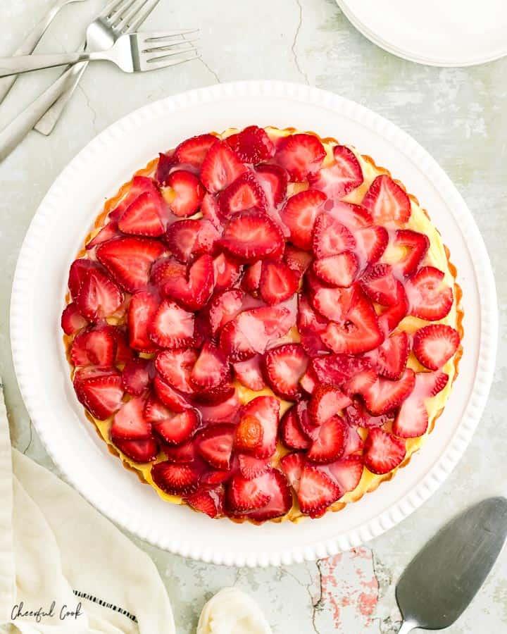 Strawberry Torte (Erdbeerkuchen) on a white cake stand ready to be served