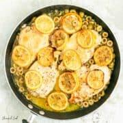 roasted lemon chicken in a black pan