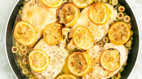 roasted lemon chicken in a black pan
