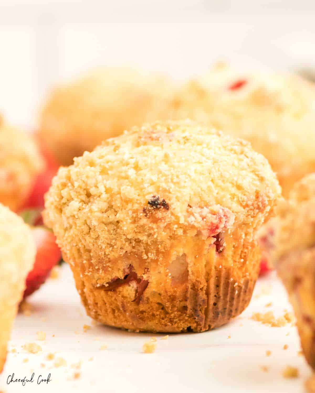 a freshly baked strawberry streusel muffin