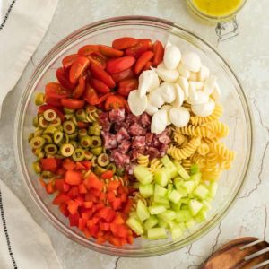 a large salad bowl filled with all the ingredients needed to make Italian Pasta Salad