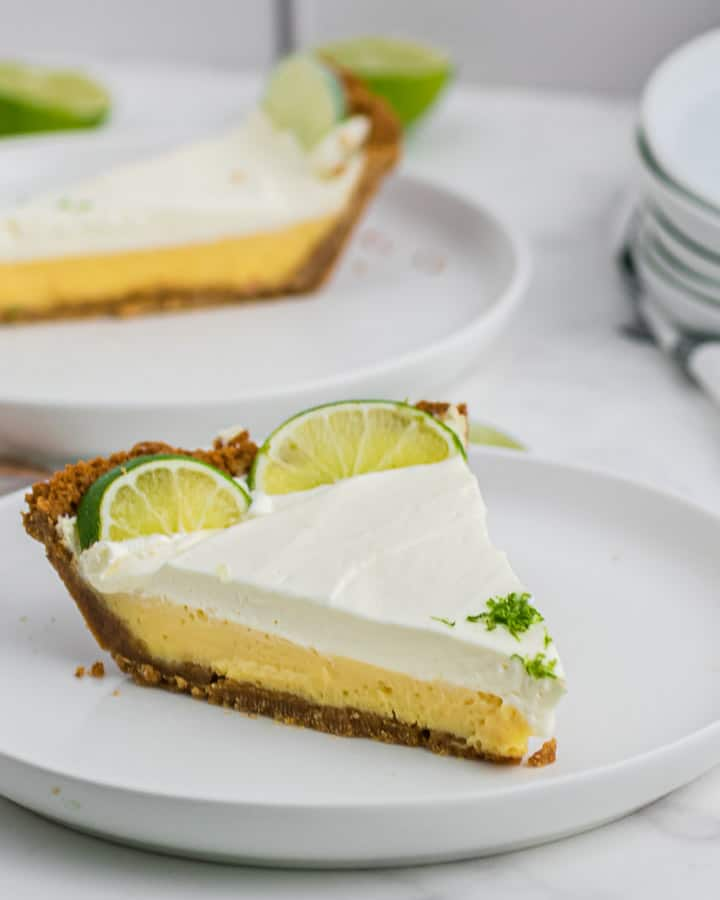 A slice of the best key lime pie served on a white plate