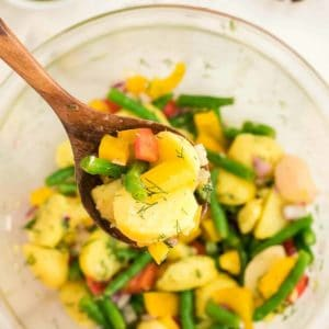 a spoonful of freshly made Potato and Green Bean Salad