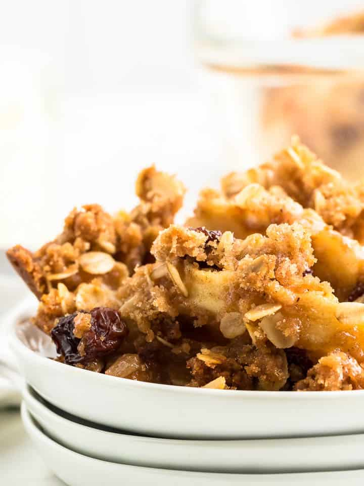 a closeup of apple crisp served on a white plate