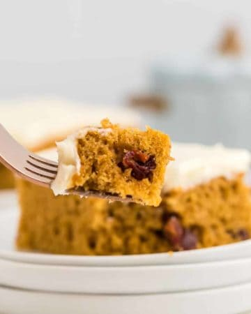 a forkful of a piece of freshly baked pumpkin bars