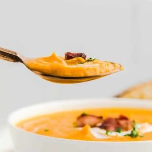 a spoonful of loaded Sweet Potato Soup