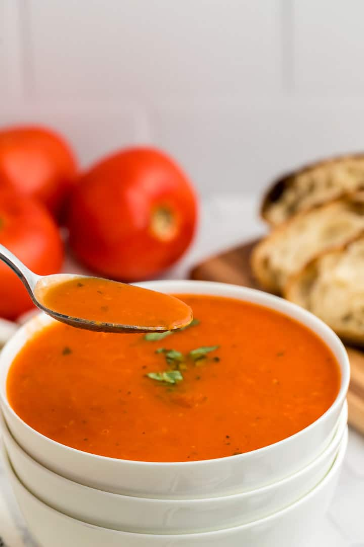 a spoonful of hot, freshly cooked tomato soup