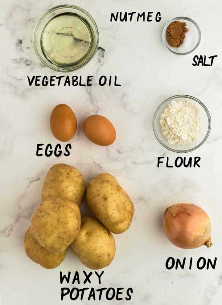Ingredients needed to make German Potato Pancakes: waxy potatoes, onion, eggs, flour, nutmeg, salt, and, oil for frying