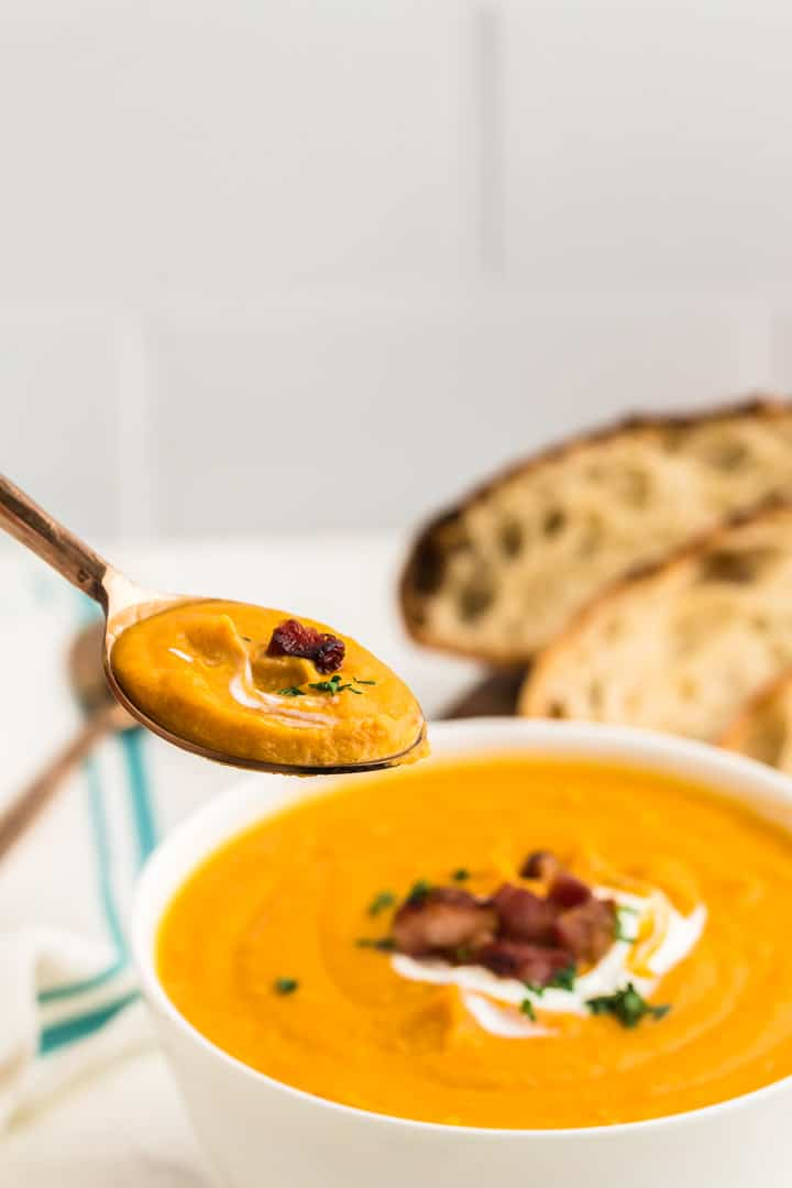 a spoonful of freshly cooked creamy sweet potato soup