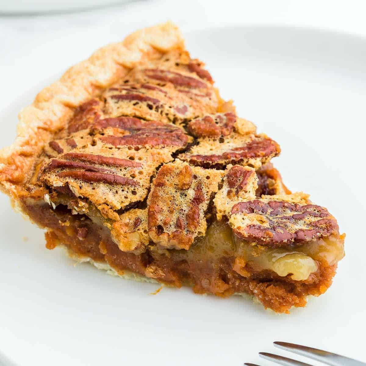 A closeup of a slice of freshly baked a Sweet Potato Pecan Pie