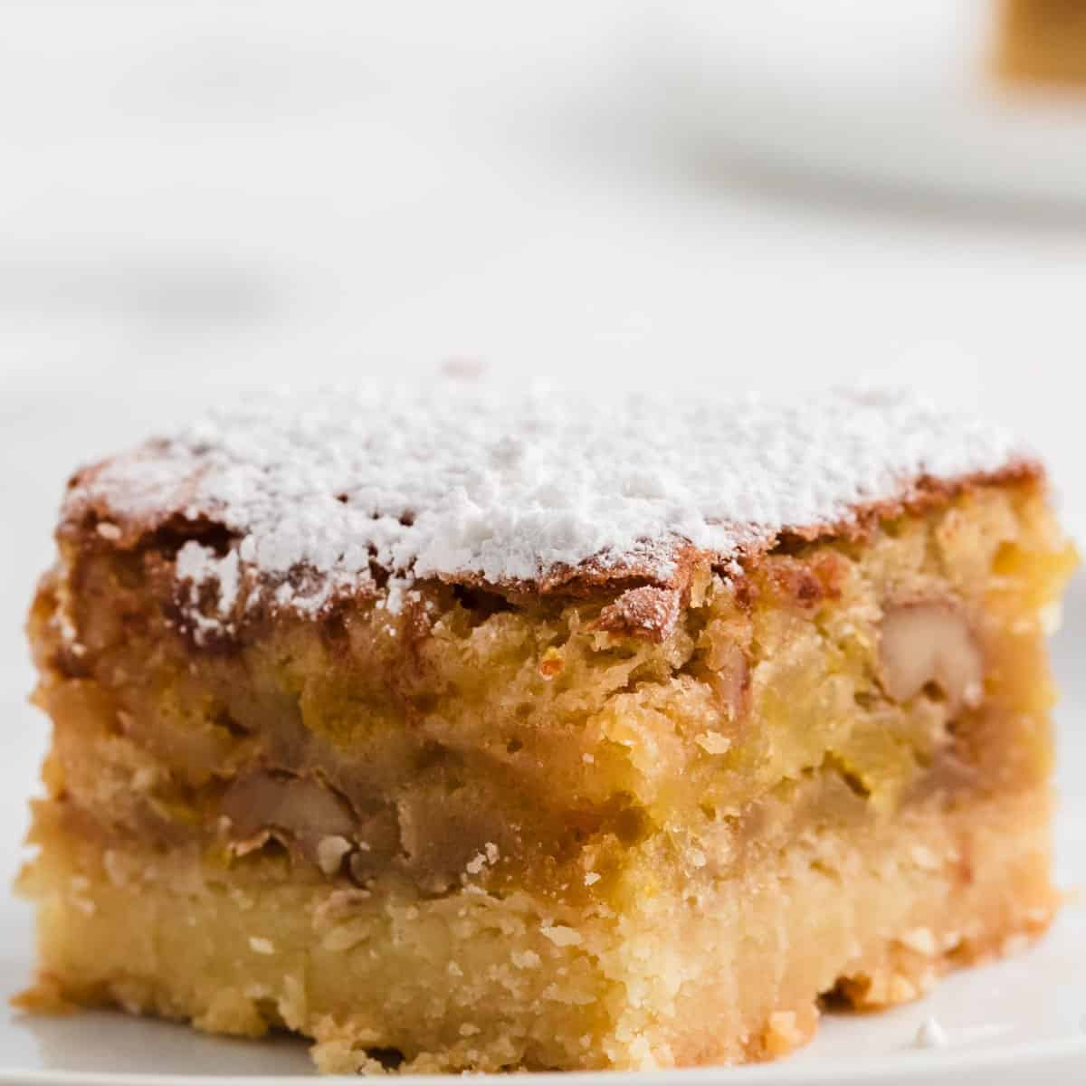 a slice of freshly baked apricot bars dusted with powdered sugar