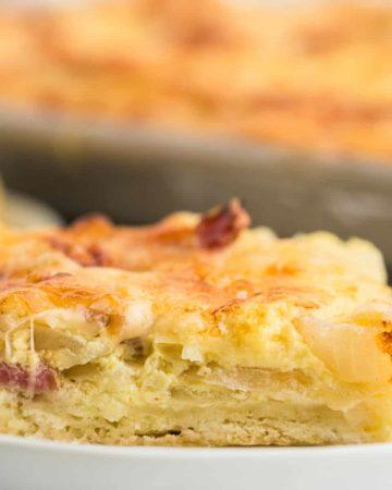 a slice of freshly baked onion pie (German Zwiebelkuchen)