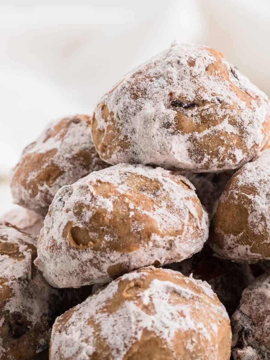a stack of freshly baked, sugar dusted butterballs