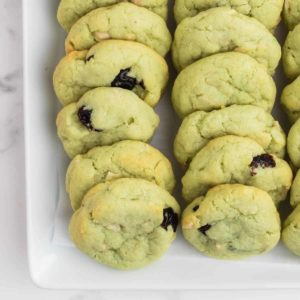 Freshly baked Pistachio Cookies on a white plate