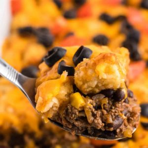 a closeup of a spoonful of freshly cooked taco tater tot casserole