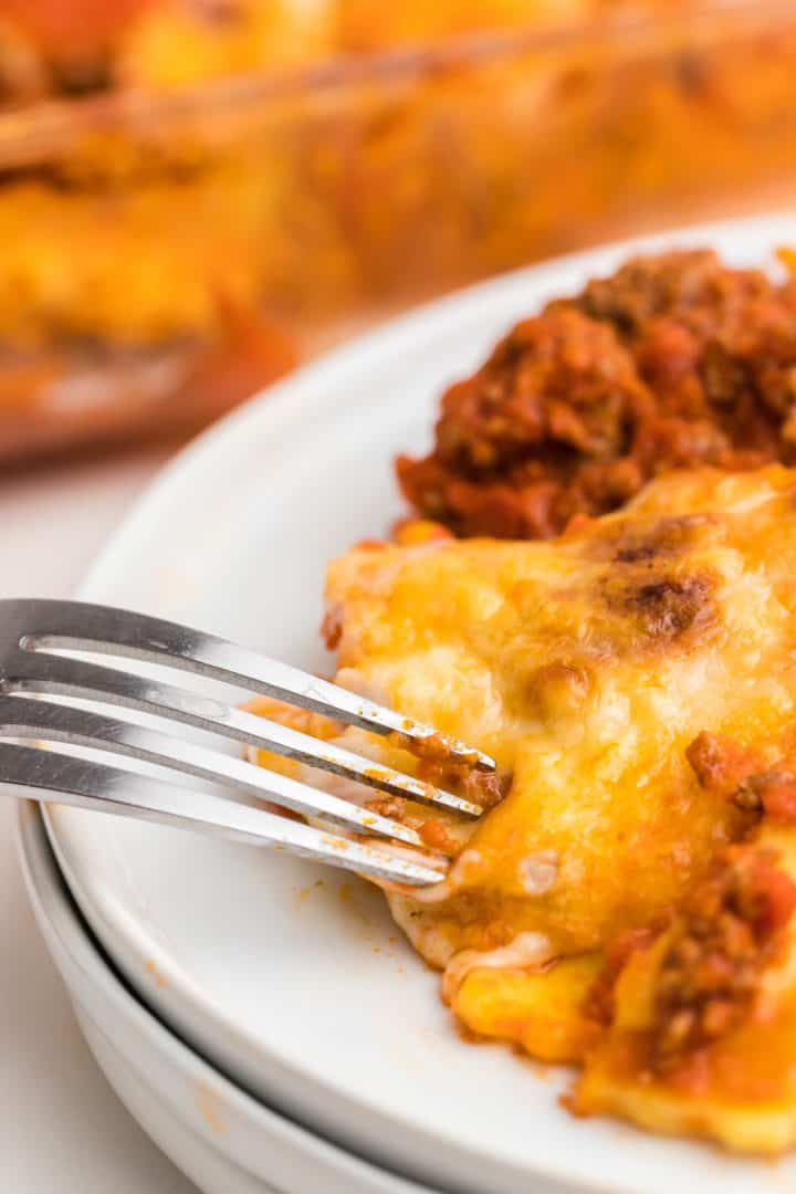 digging into the Lazy Lasagna served on a white plate