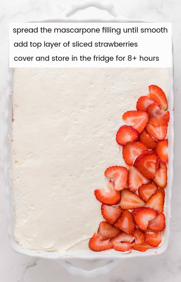 adding the final layer of sliced strawberries on top of the evenly spread mascarpone cream filling