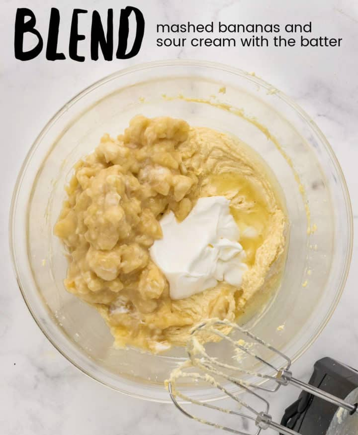 adding mashed bananas and sour cream to the batter