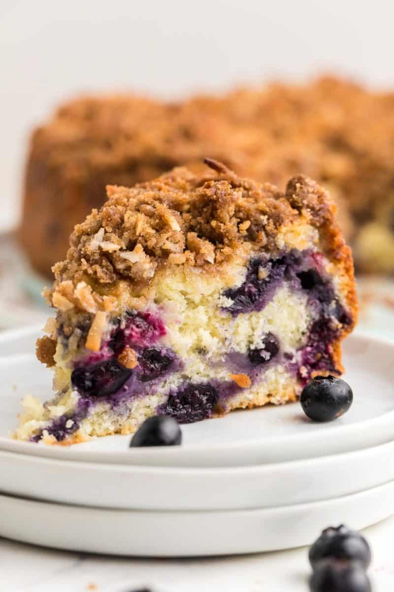 a slice of Blueberry Coffee Cake on a white plate