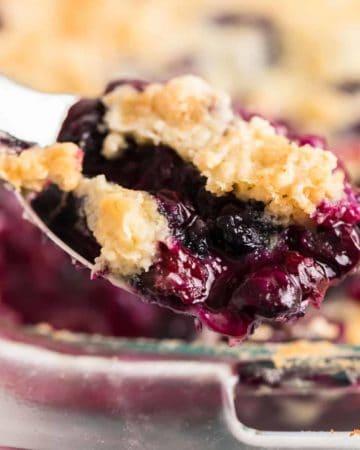 a scoop of freshly baked blueberry dump cake