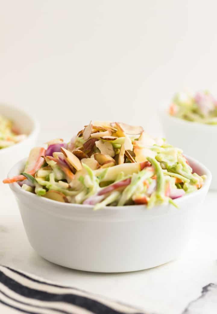 broccoli slaw in a white serving bowl