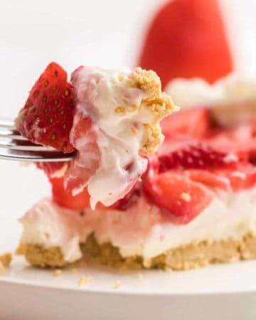 a bite of freshly prepared creamy Strawberry Pie.