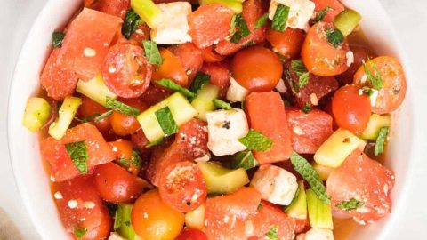 top down image of a freshly prepared watermelon salad served in a white bowl