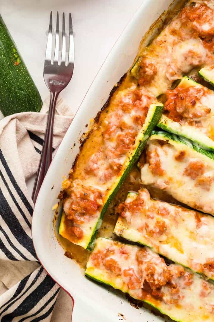 Stuffed Zucchini Boats in a casserole dish fresh from the oven