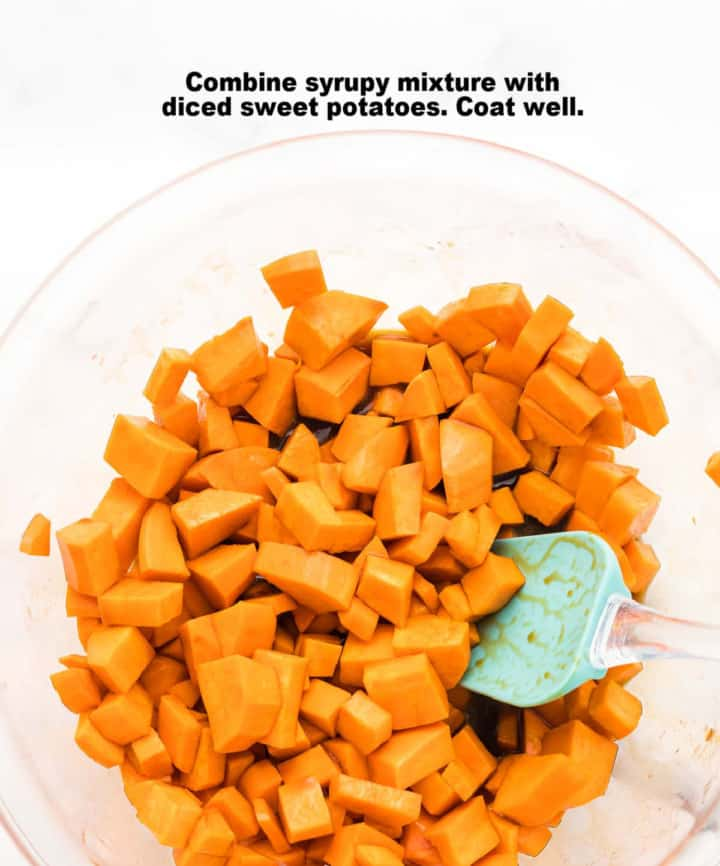 process step 2: diced sweet potatoes in a glass bowl tossed in the sugar and balsamic vinegar mixture