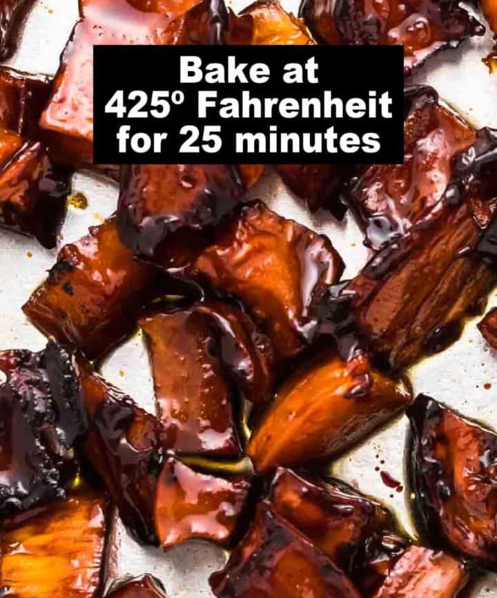 process step 3: candied sweet potatoes on a baking sheet after baking for 25 minutes at 400º Fahrenheit