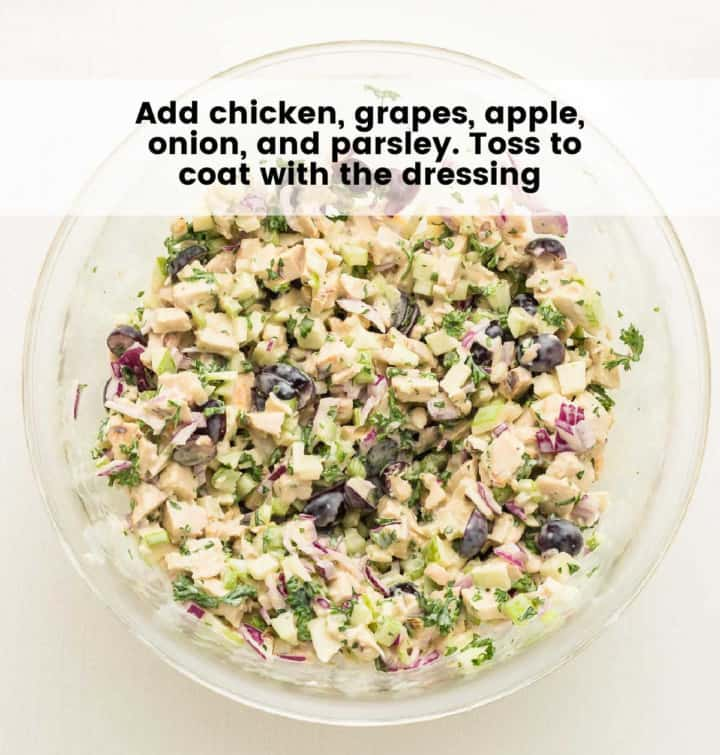 tossed chicken salad in a glass bowl