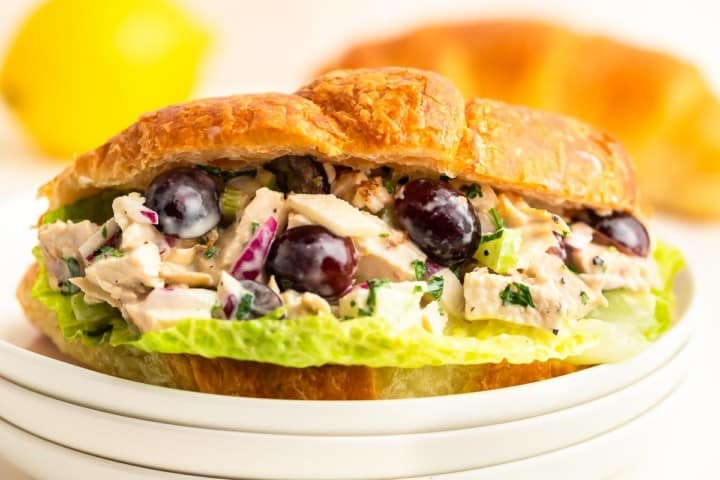 closeup of chicken salad served in croissant