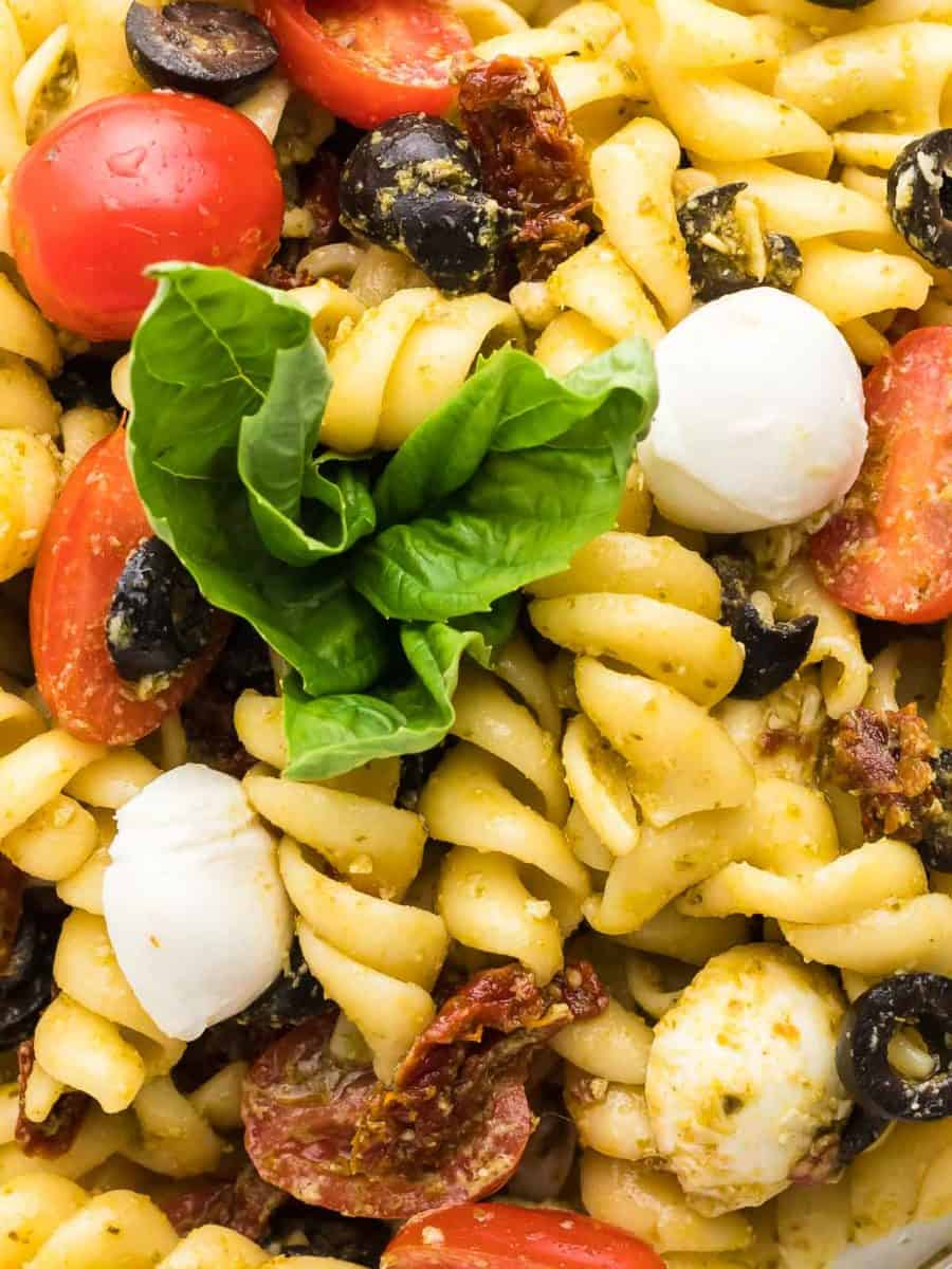 closeup of a pesto pasta salad showing the various ingredients that make this salad so tasty