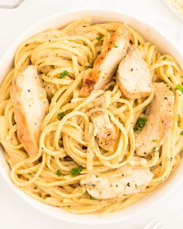 Chicken Alfredo in a white bowl