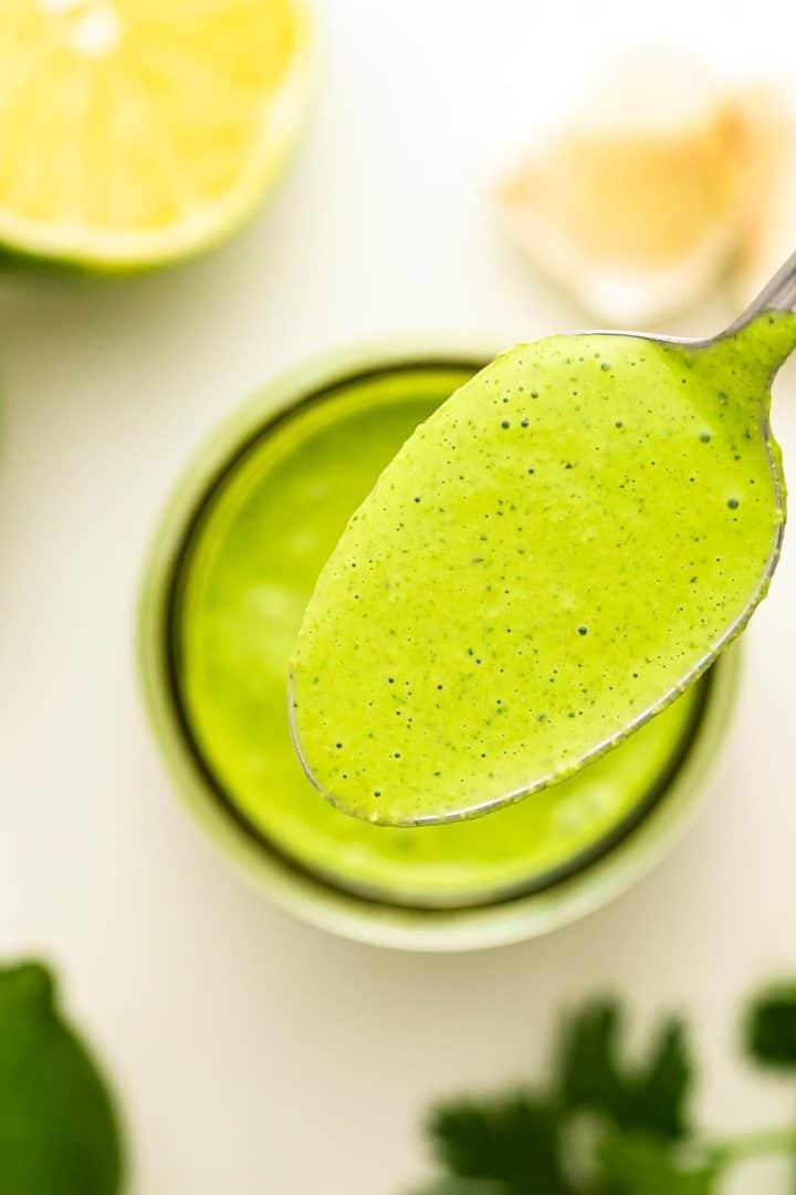 a closeup of a spoonful of creamy cilantro dressing
