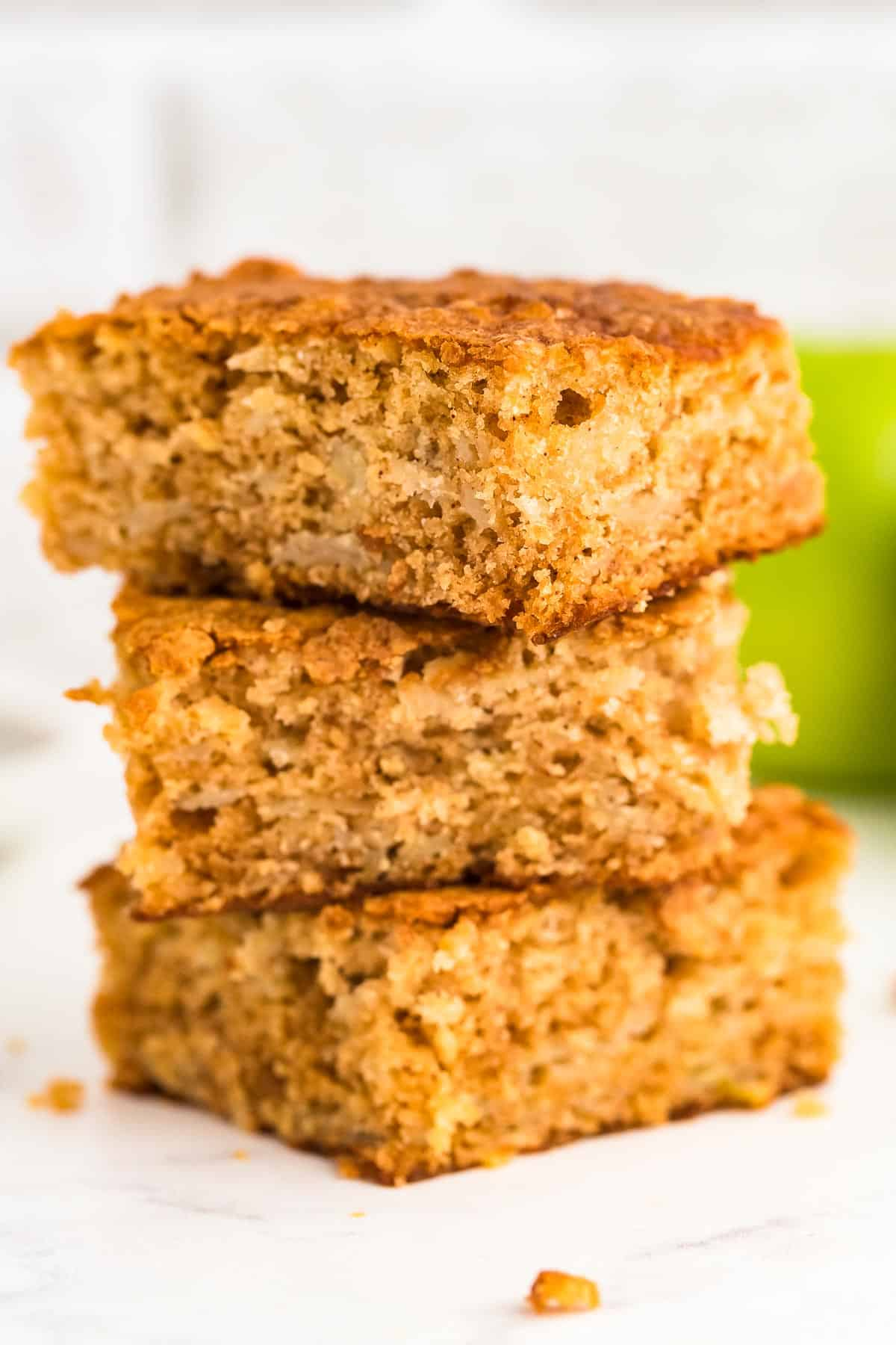 a stack of freshly baked slices of Apple Cake