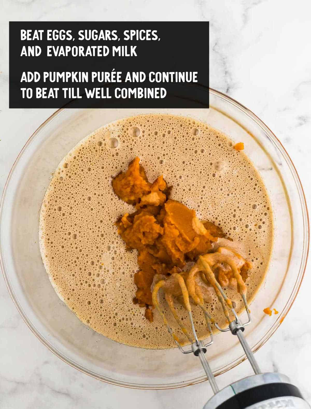 adding the pumpkin puree to the batter