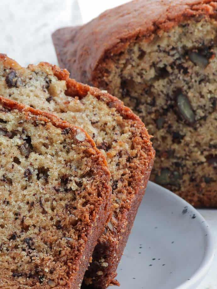 Two warm slices of fresh banana nut bread