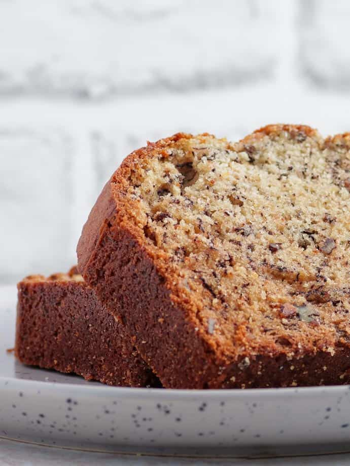 Grab a slice from this plate of fresh, moist banana nut bread