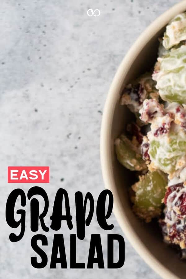 A bowl full of Grape Salad with cranberries and Graham Crackers