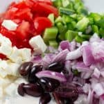 Greek Salad ingredients: cucumber, green bell pepper, tomato, red onion, feta, olives