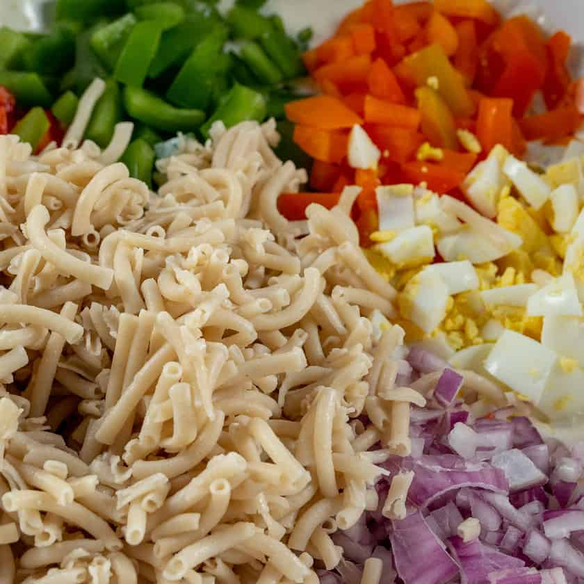 Amish Macaroni Salad including red, orange, and green bell peppers, red onion, and egg