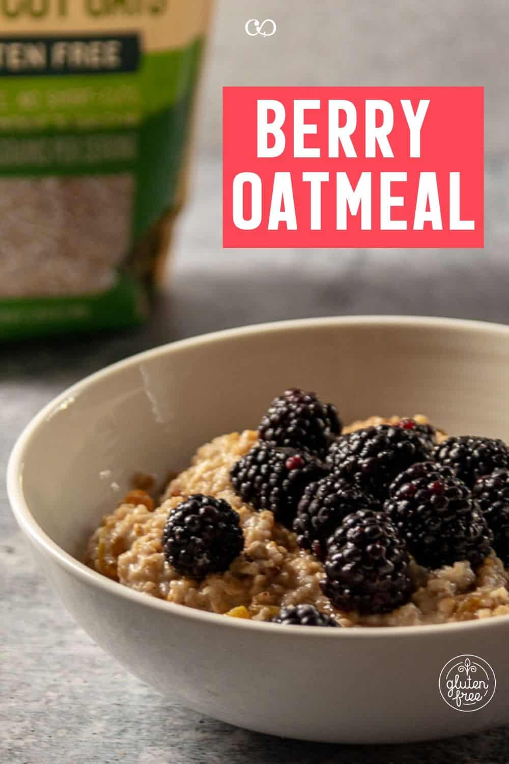 A bowl of berry oatmeal with blackberries, crushed pecans, and maple syrup and a bag of steel cut oats